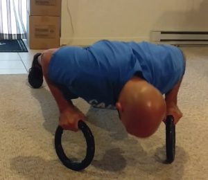 Ring push-ups for the development of hands and wrists